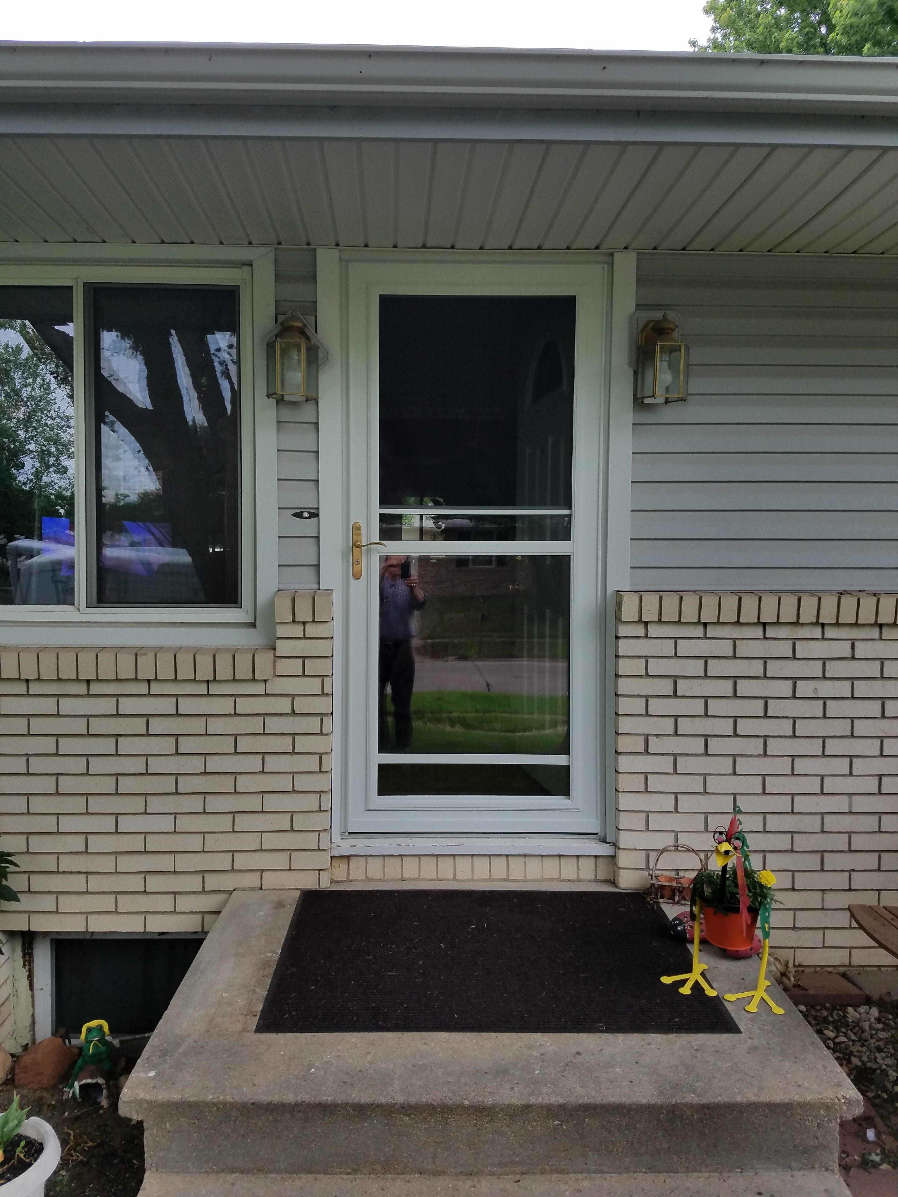 new-self-storing-storm-door